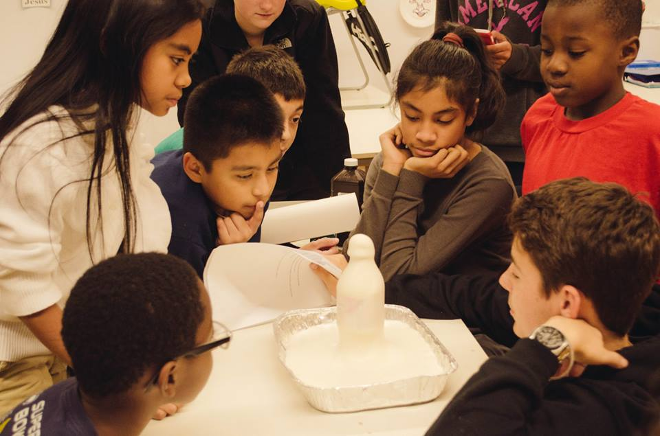 """By combining, hydrogen peroxide, dish soap, food coloring, and yeast they created a chemical reaction otherwise known as """"Elephant Toothpaste."""""""