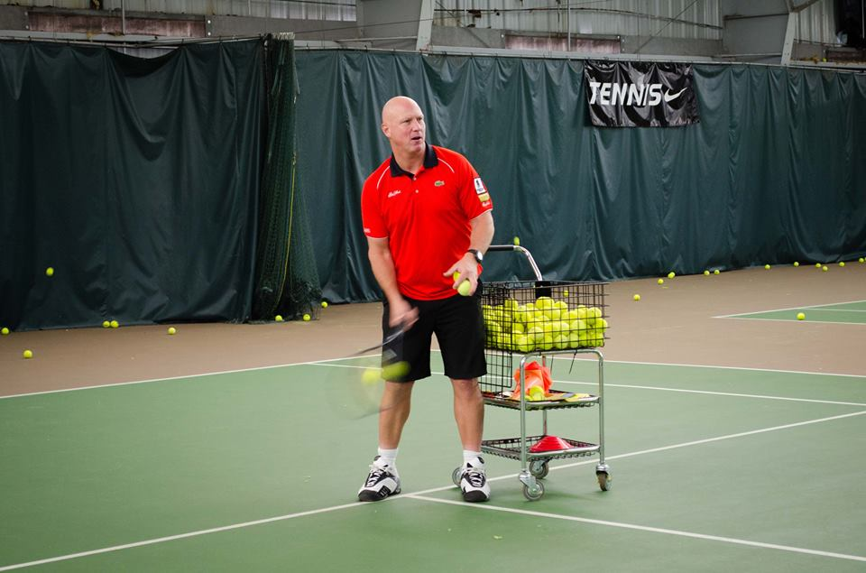 """""""Dual-Hand Luke"""" feeds tennis balls to the players during the clinics."""