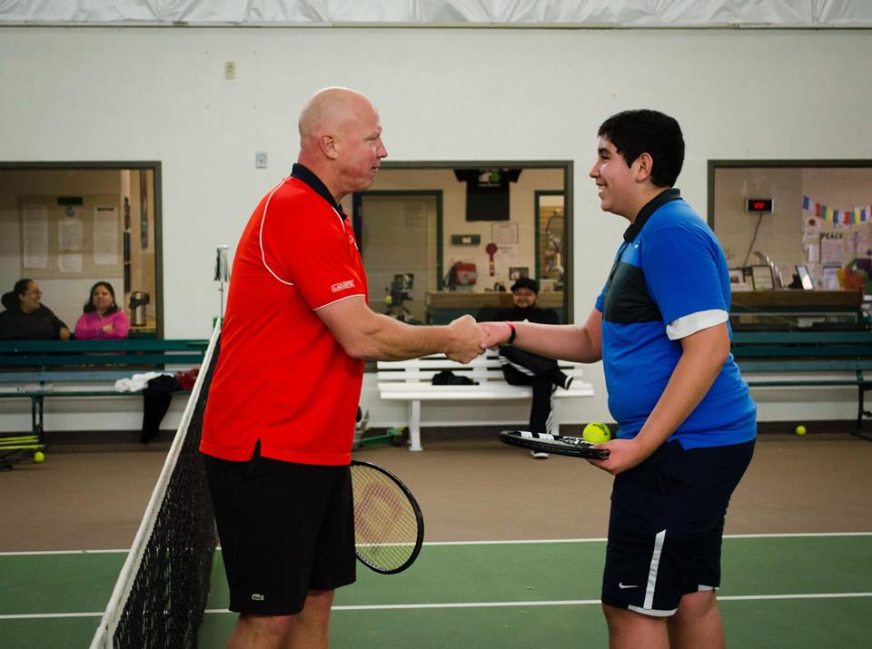 Luke congratulates his temporary partner, Alberto, after their hard fought match during the clinic.