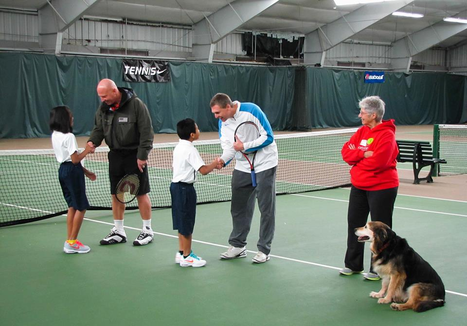 Ashley and Alex shake hands with Luke Jensen and Jonathan Stark prior to the beginning of the junior clinic at PAST&E. The Scholar Athletes were thrilled to meet these two Grand Slam tournament champions!