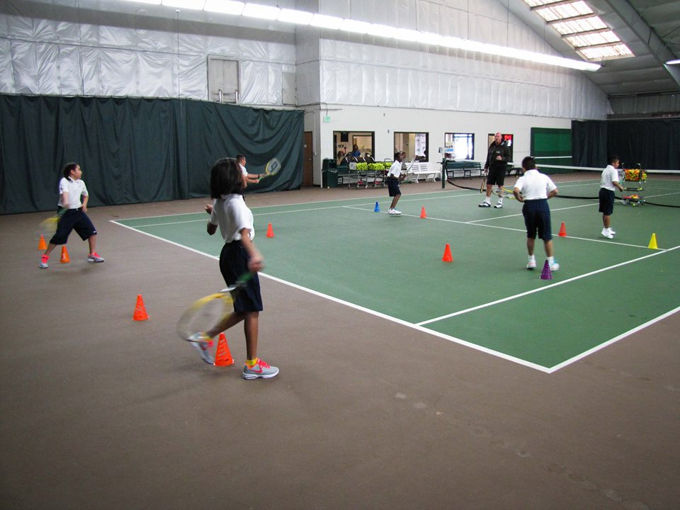 Scholar Athletes practice their footwork for forehands and backhands.