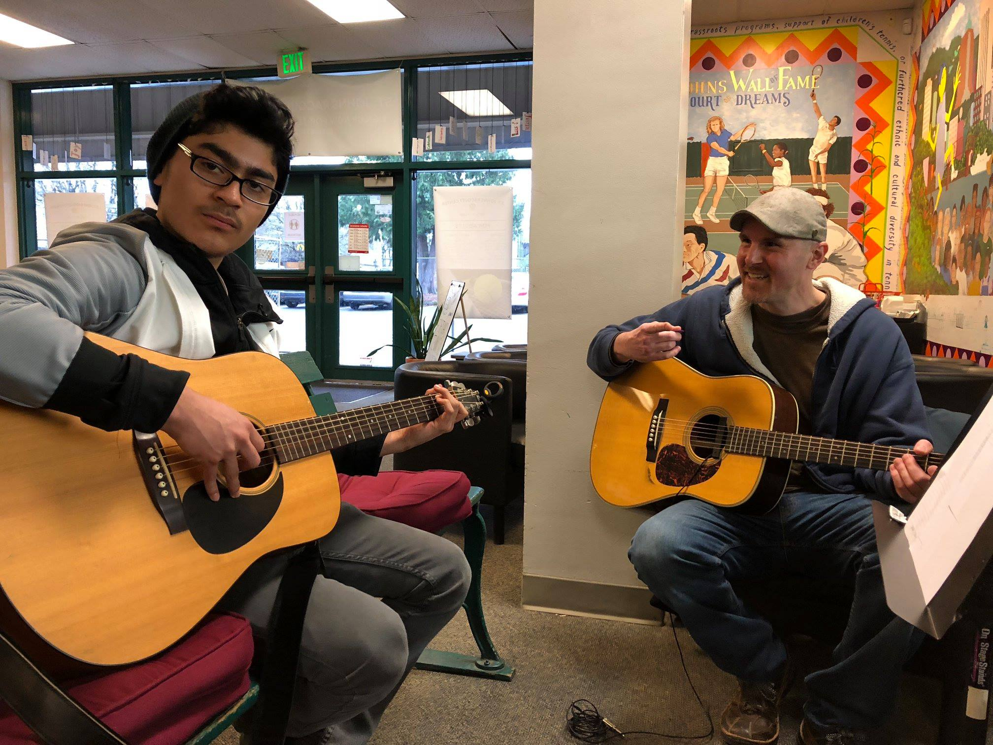 Coach Jason working with Oscar one of the stars of our PT&E Music Program