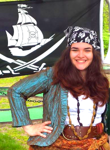 Elora the Sea Singin' Shanty  Music is found in her soul, this buccaneer made her way just nicely into the upper ranks of our crew where she grew and grew in energy and skill aboard our very own Island Rogue, sailed away for the winter but due to return soon!