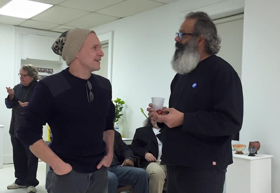 ReDRooM artist Bill Buckley talks with gallery Director Renny Molenaar during the reception.