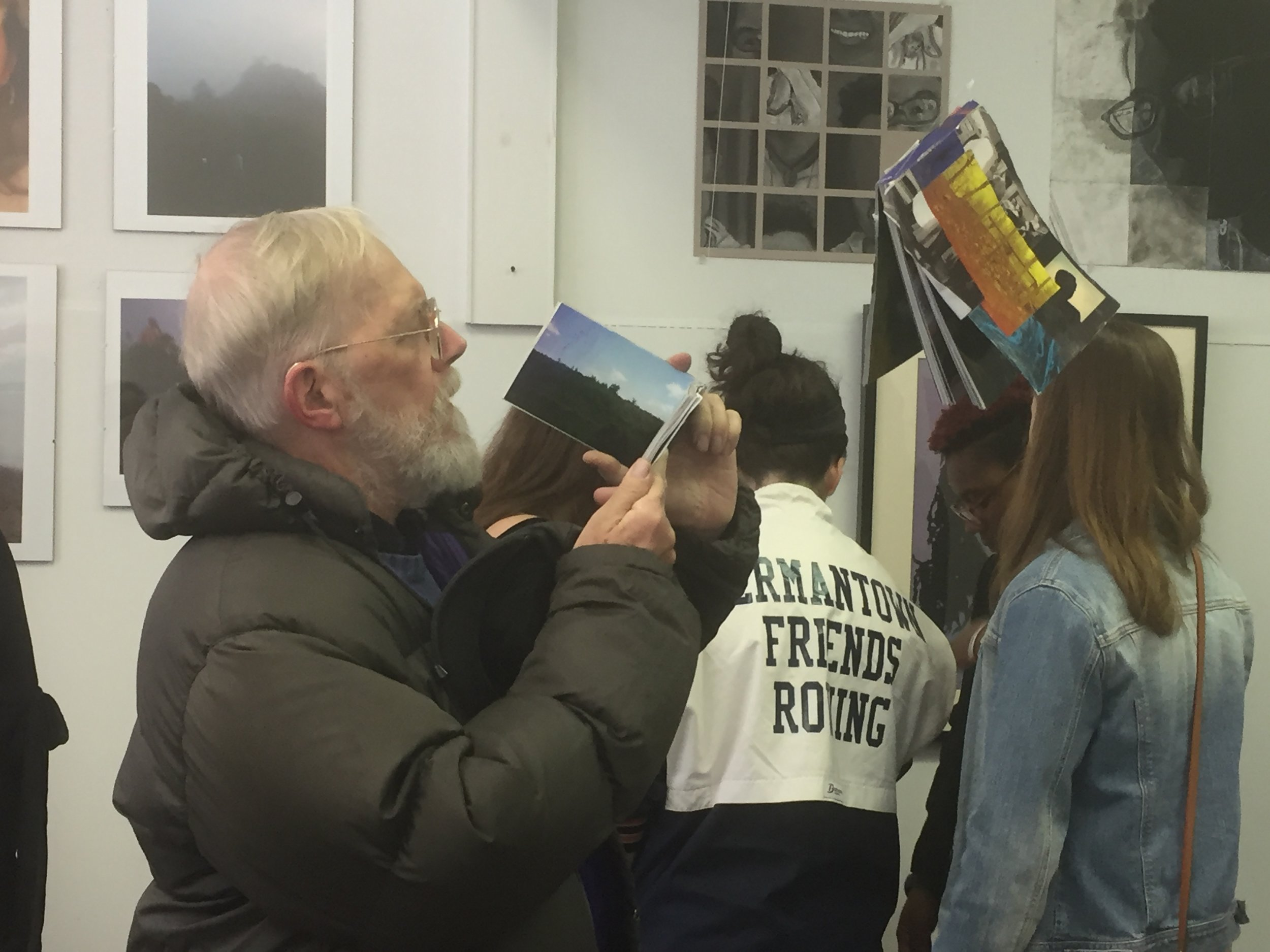 Opening Night, hanging photo books by Emily Ecclestone