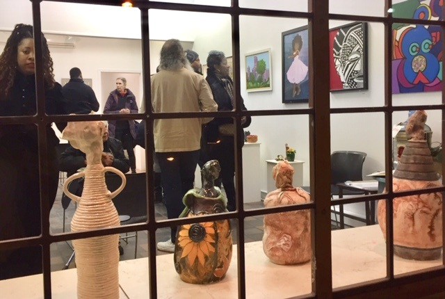 Opening night, ceramic pieces by the window by Meri Adelman