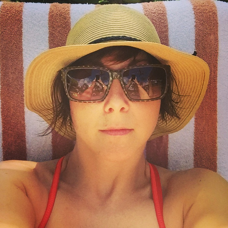 Me, poolside and pre-burned.