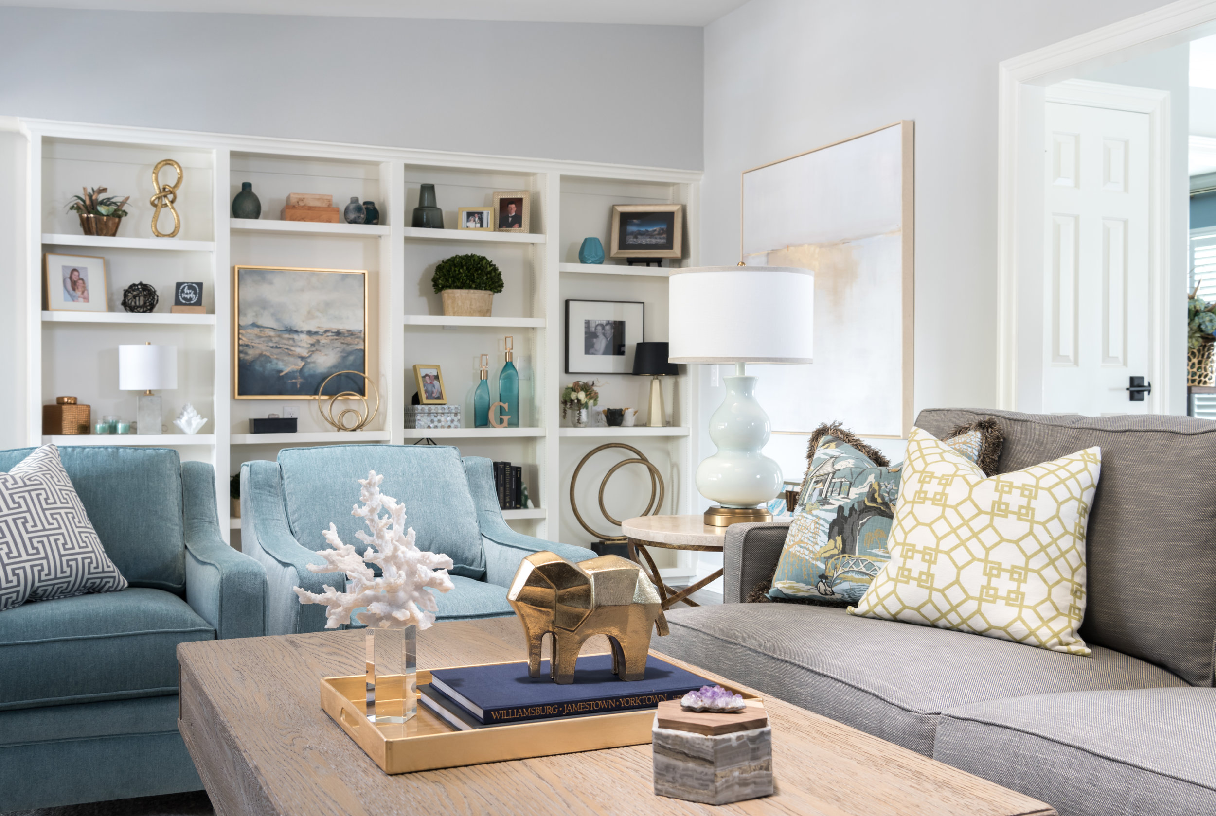 In this home, we kept it simple and left plenty of room for family photos. Taking out a shelf and adding a larger piece of art creates a focal point and allows it to feel less cluttered. Source: Studiosteidley.com