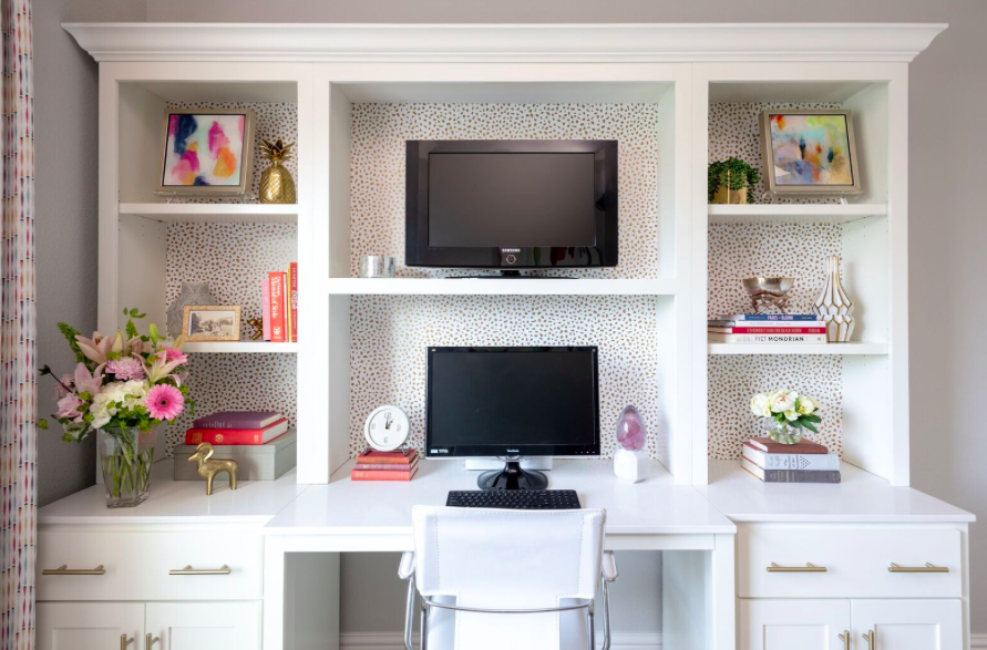 In a home office, you want to combine decorative and practical pieces. Here, we combined books used for reference, boxes for organizing, and beautiful artwork. Source:  studiosteidley.com