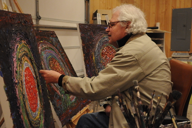 Dr. Steven Nissen working on his paintings. (Photo credit: Lyndsay Nissen)