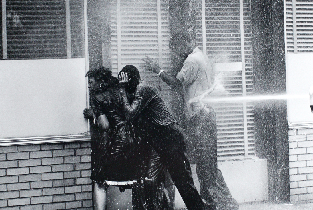 Charles Moore,Firefighters aiming high-pressure water hoses at civil rights demonstrators, Birmingham, Alabama(1963),Gelatin silver print image, 8 1/4 x 12 1/4 inches