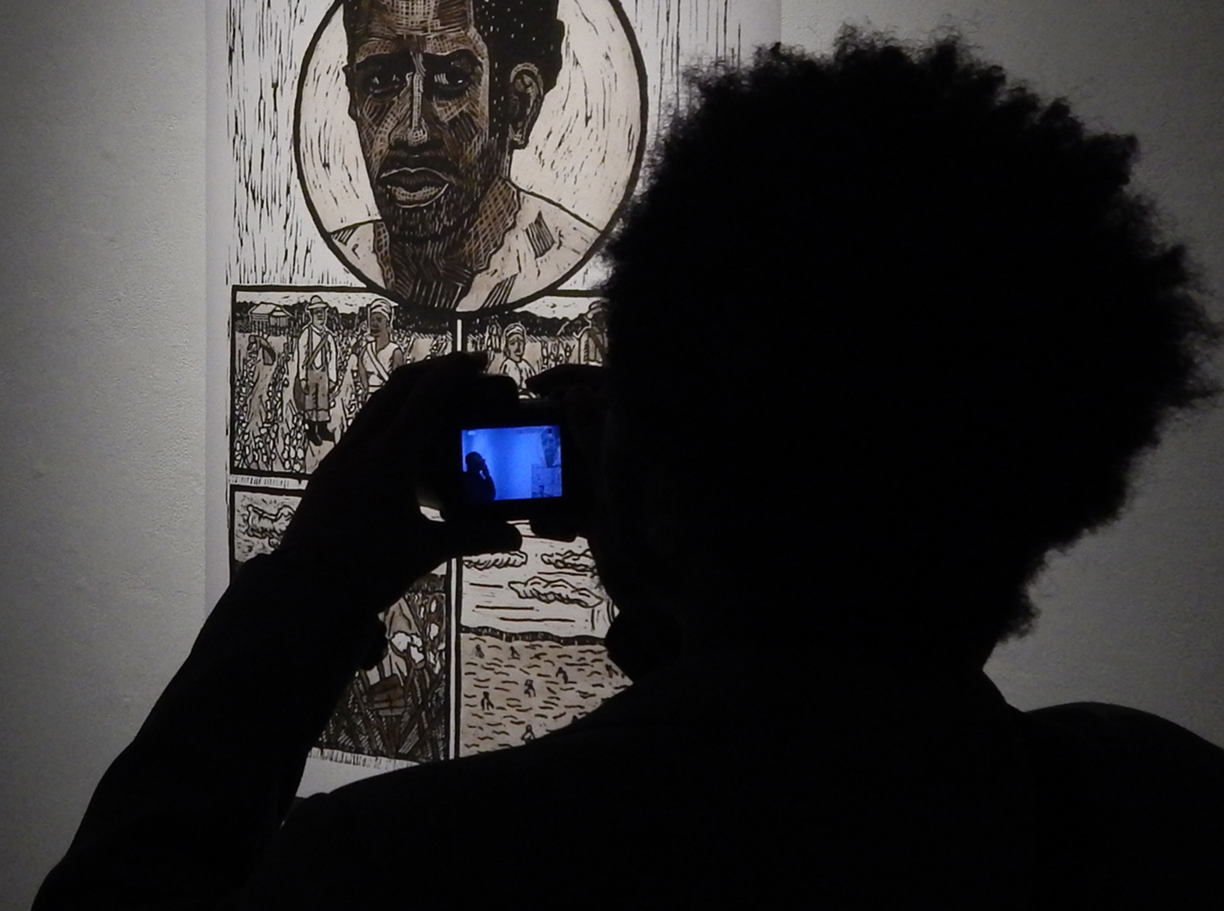 """Craig Ross, """"Steal Away: The Visions of Nat Turner."""" pages on display during the """"Didactic Art Show"""" (2014)"""