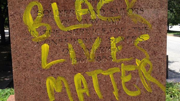 "The statue's pedestal was hit with ""Black Lives Matter"" graffiti.  (Credit: Kevin Rector/Baltimore Sun)"