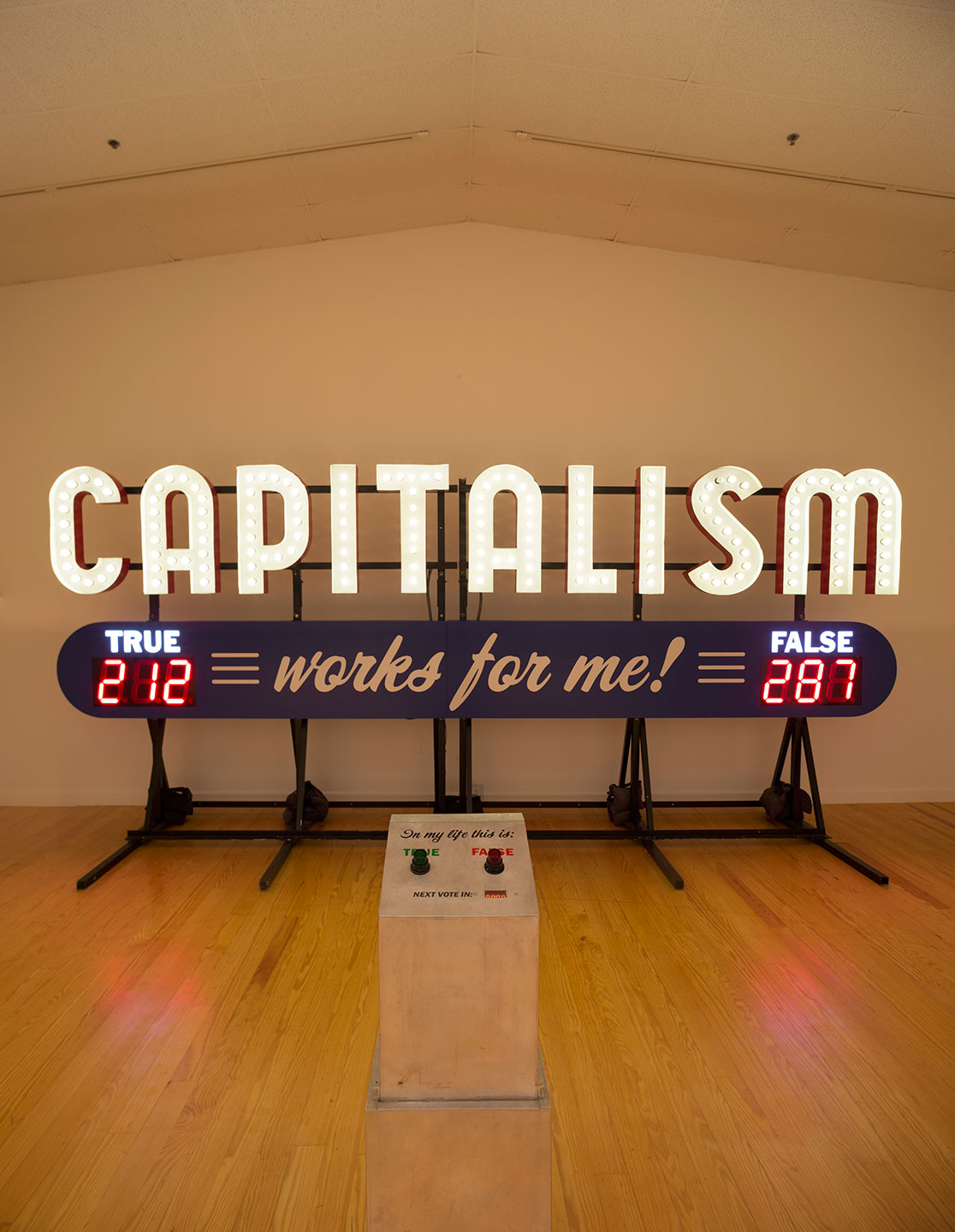 Steve Lambert  Capitalism Works For Me! True/False  (2011) Aluminum and electrical 9 x 20 x 7 feet