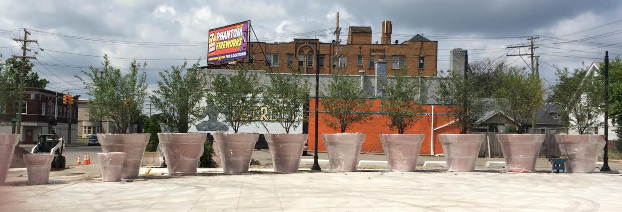 Grosse Pointe's prelude to the fence: blocking Detroit traffic with giant potted plants.