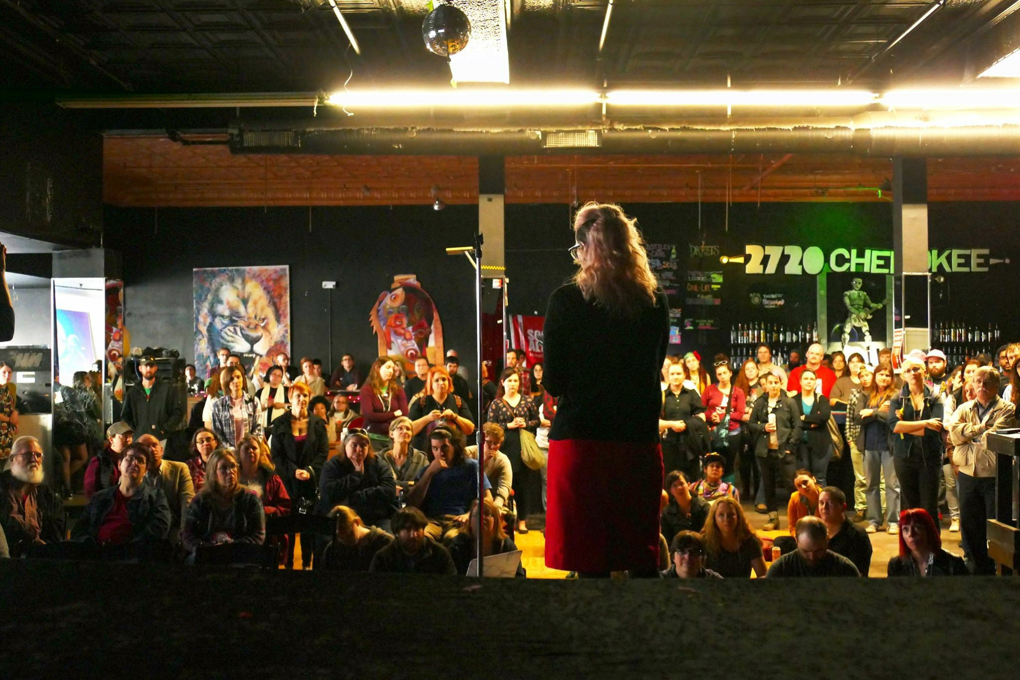 "Stephanie Dinges speaking at a ""mass meeting"" organized by St. Louis Socialist Alternative to discuss resistance to the Trump administration. Photo by Richard Reilly."