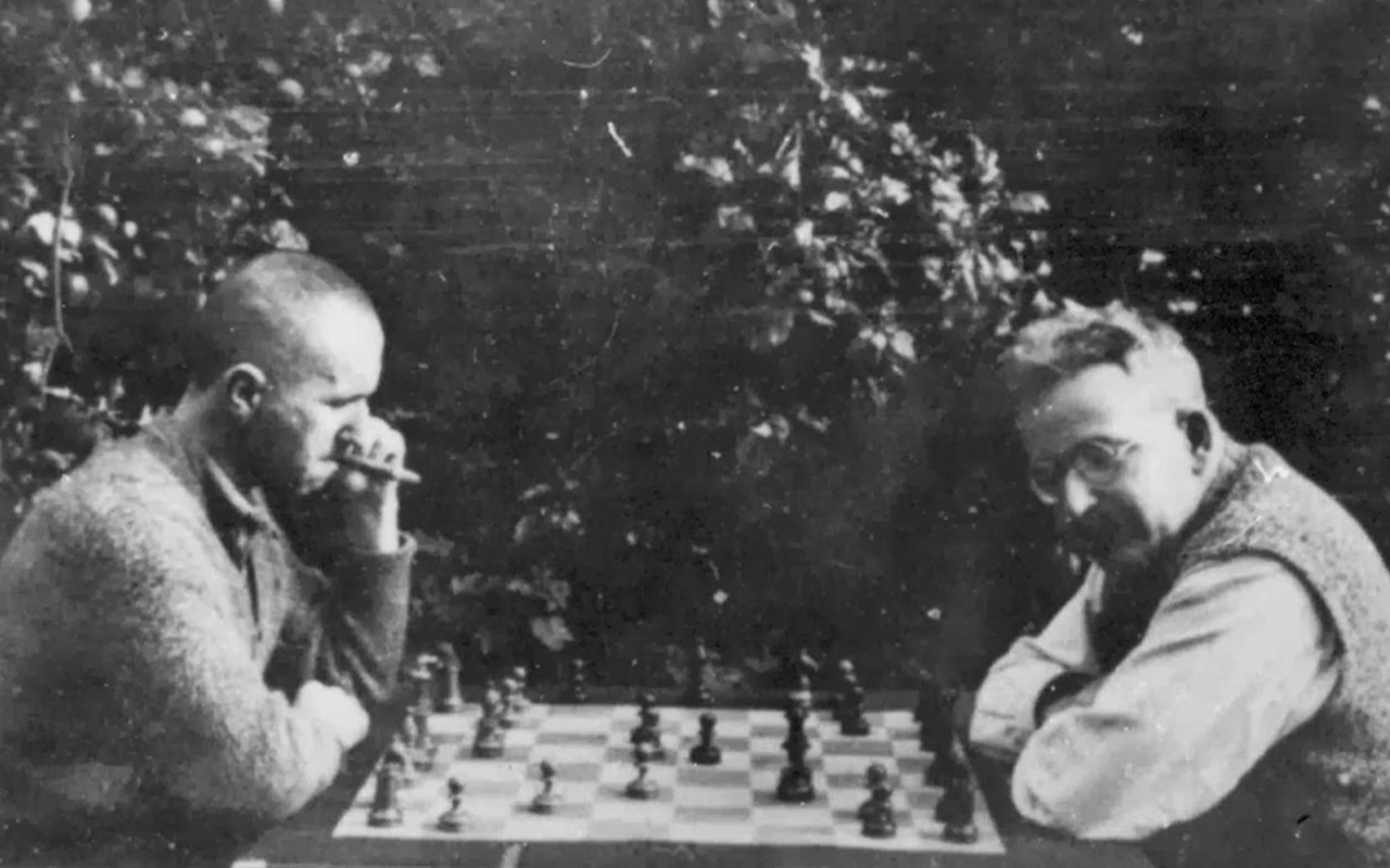 Brecht (left) plays chess with Walter Benjamin (right).