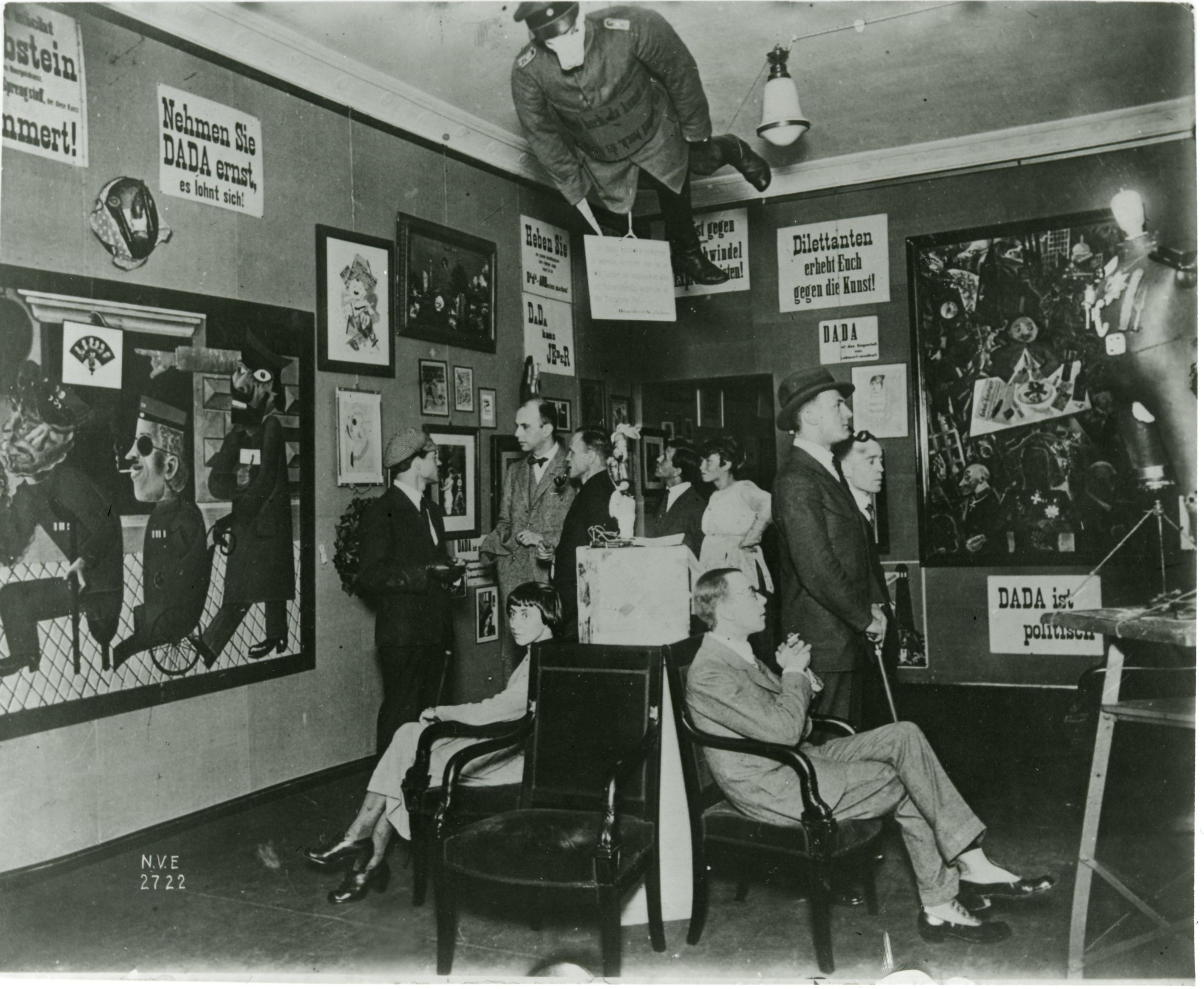 First International Dada Fair (Berlin 1920). Berlin Dada pioneered many aspects of modern, and capitalist, art and culture; assemblage, collage, montage, the indexical object and the media stunt, and did so in solidarity with the unfolding German Revolution. Several artists from Berlin Dada were arrested following this exhibition on charges that included insulting the German Army (in particular for Rudolf Schlichter and John Heartfield's  Prussian Archangel  [above] depicting a dummy in a German military uniform wearing a pig mask).