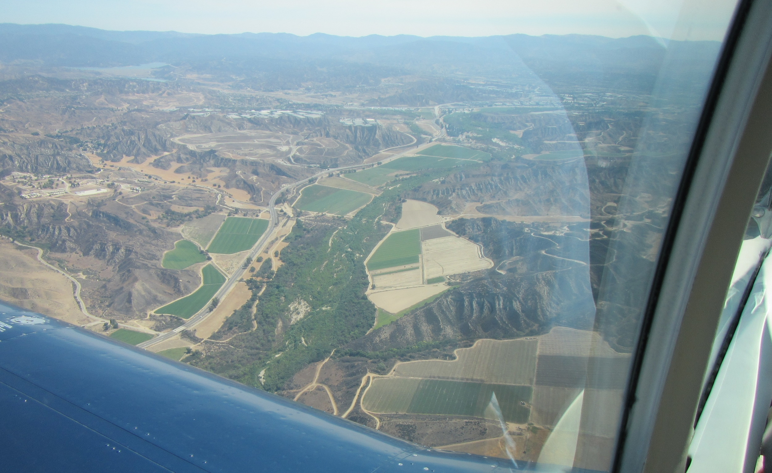 Flyover with Lighthawk of the riparian forest and open space that would be bulldozed over and concreted by the Project  .