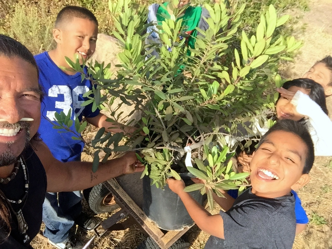 Students participating in a Native Plant Restoration.