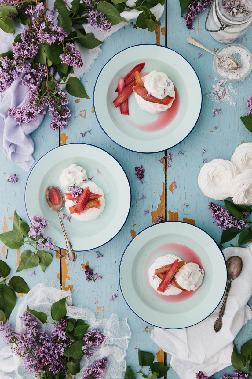 Cider-poached rhubarb and lilac whipped cream pair beautifully in this spring dessert showstopper.