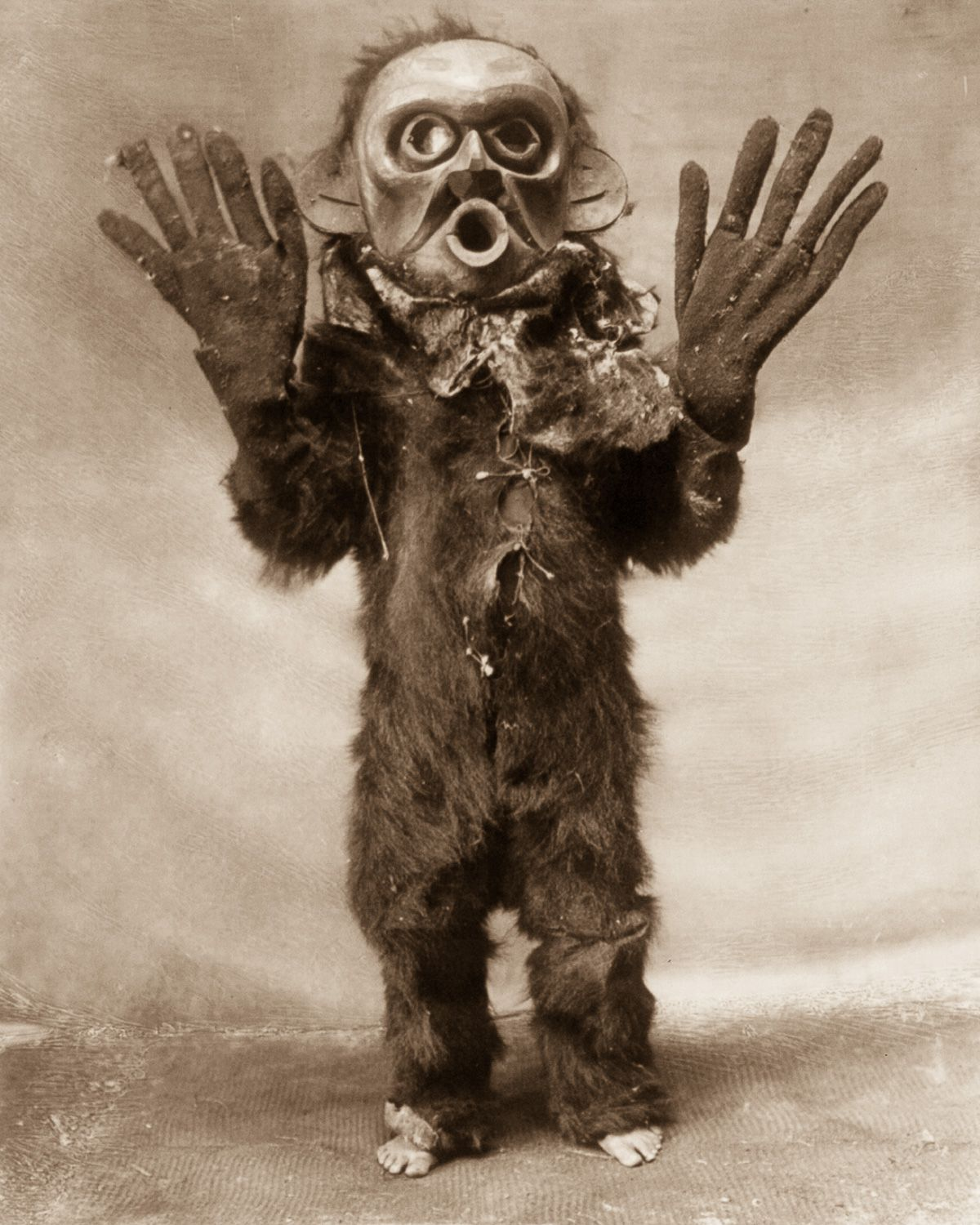 """A Koskimo man dressed as Hami (""""dangerous thing"""") during a Numhlim ceremony,  1914.  ©EDWARD S. CURTIS/LIBRARY OF CONGRESS"""