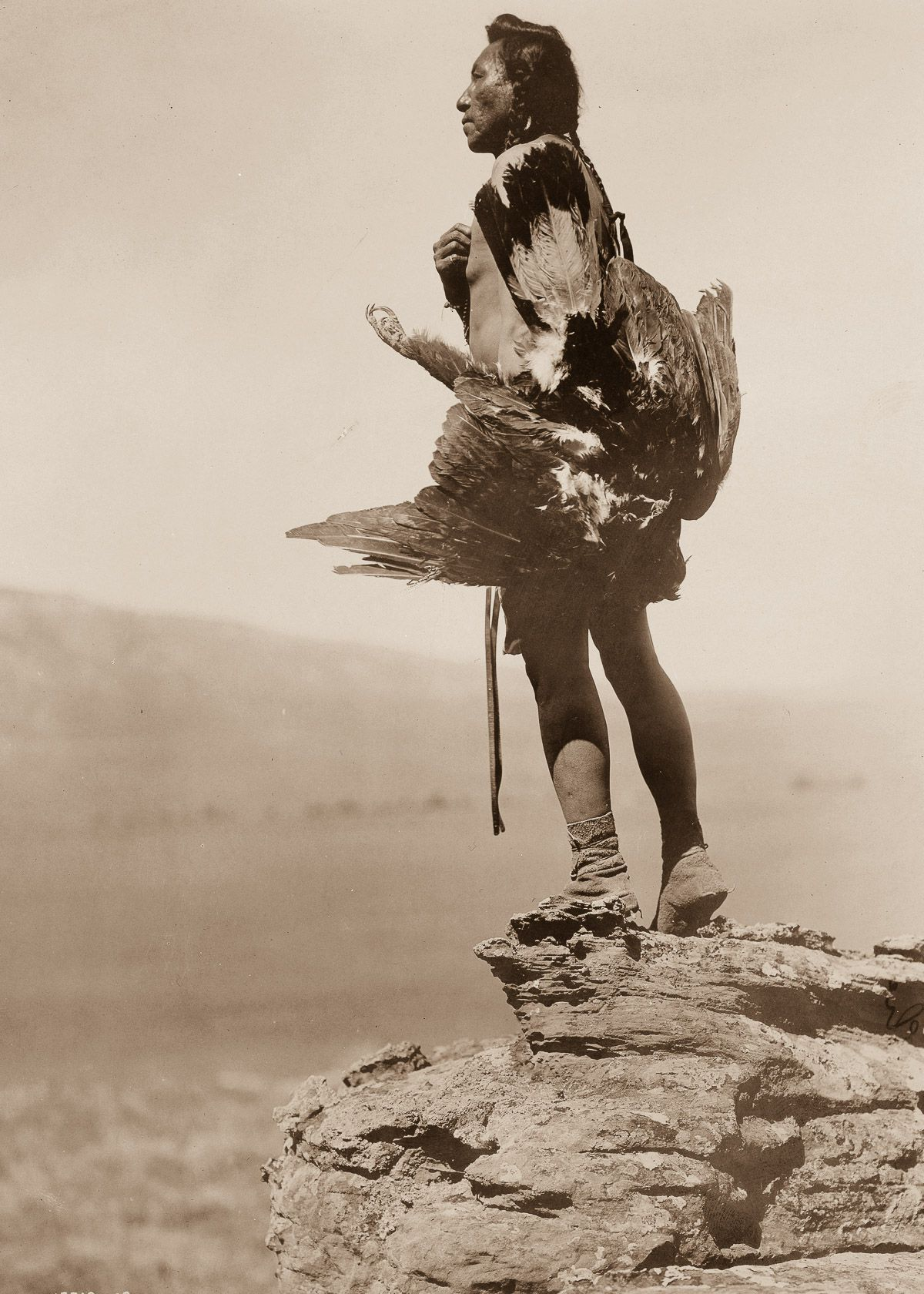 A Hidatsa man with a captured eagle,  1908.  ©EDWARD S. CURTIS/LIBRARY OF CONGRESS