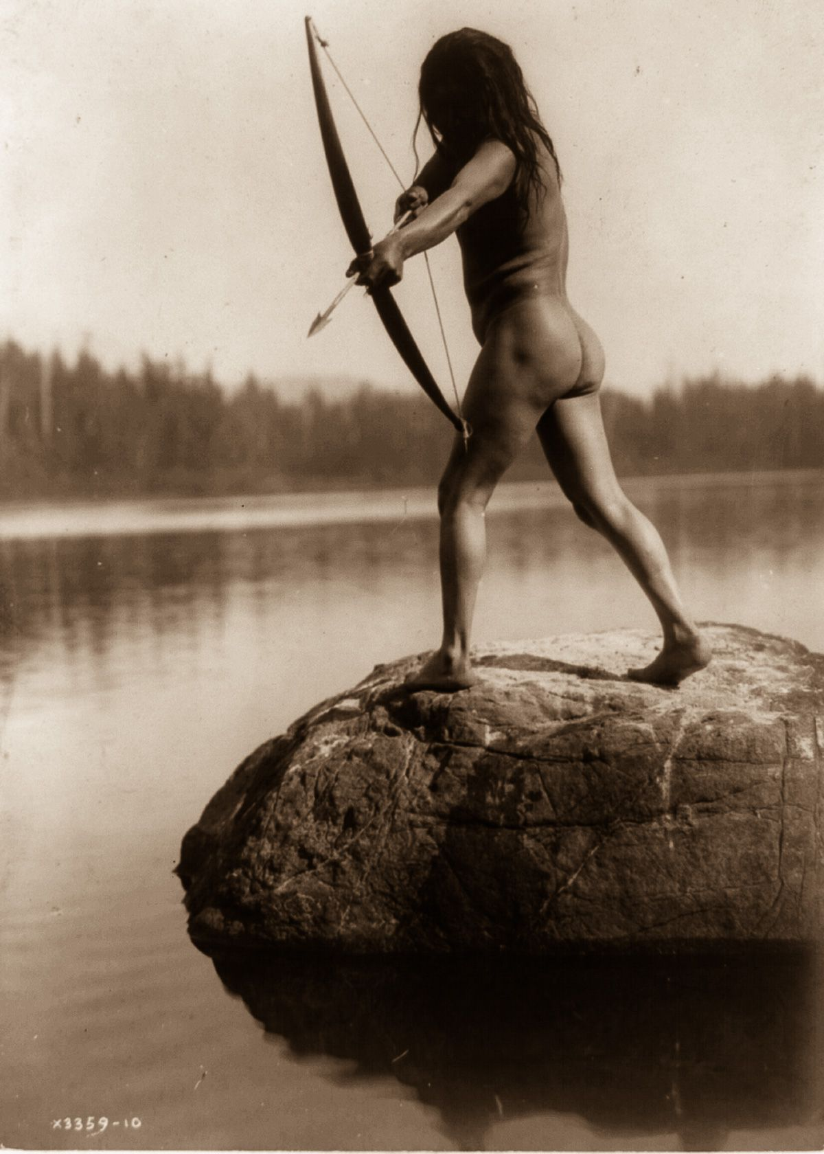 A Nootka man aims a bow and arrow,  1910.  ©EDWARD S. CURTIS/LIBRARY OF CONGRESS