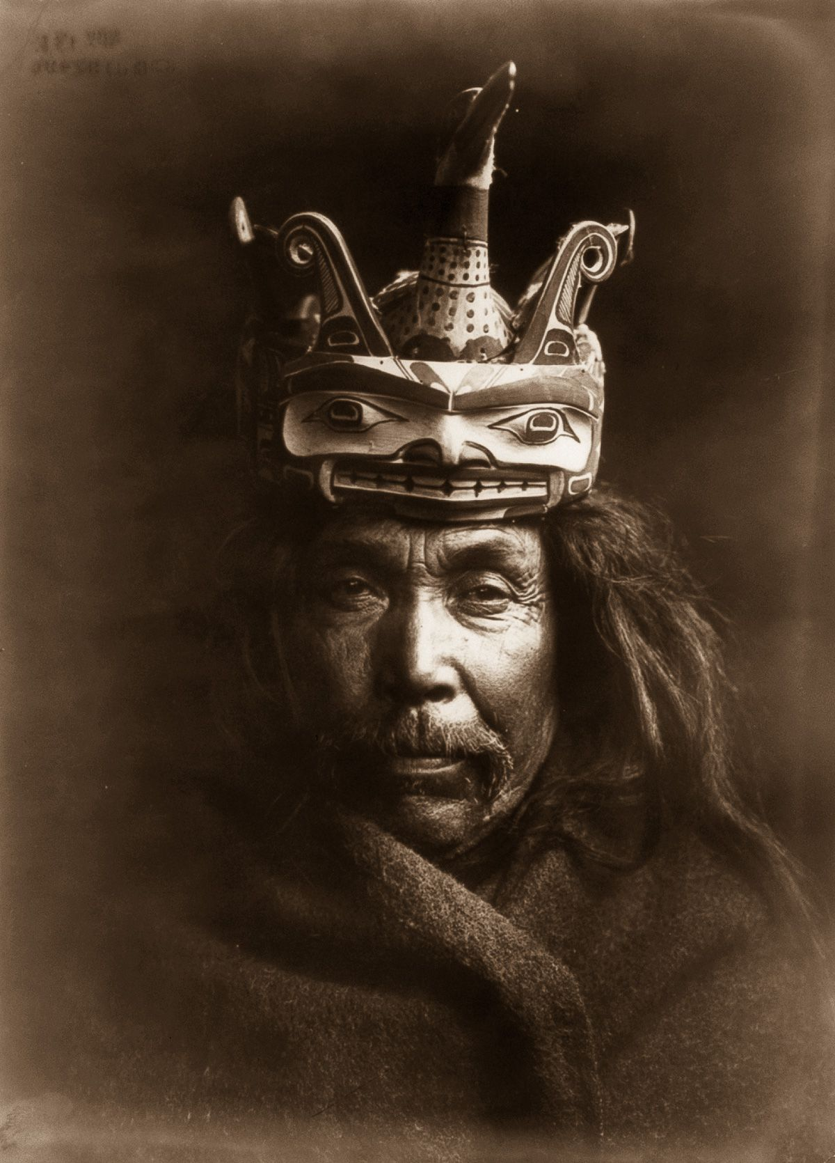 A Kwakiutl man wearing a mask depicting a man transforming into a loon,  1914.  ©EDWARD S. CURTIS/LIBRARY OF CONGRESS