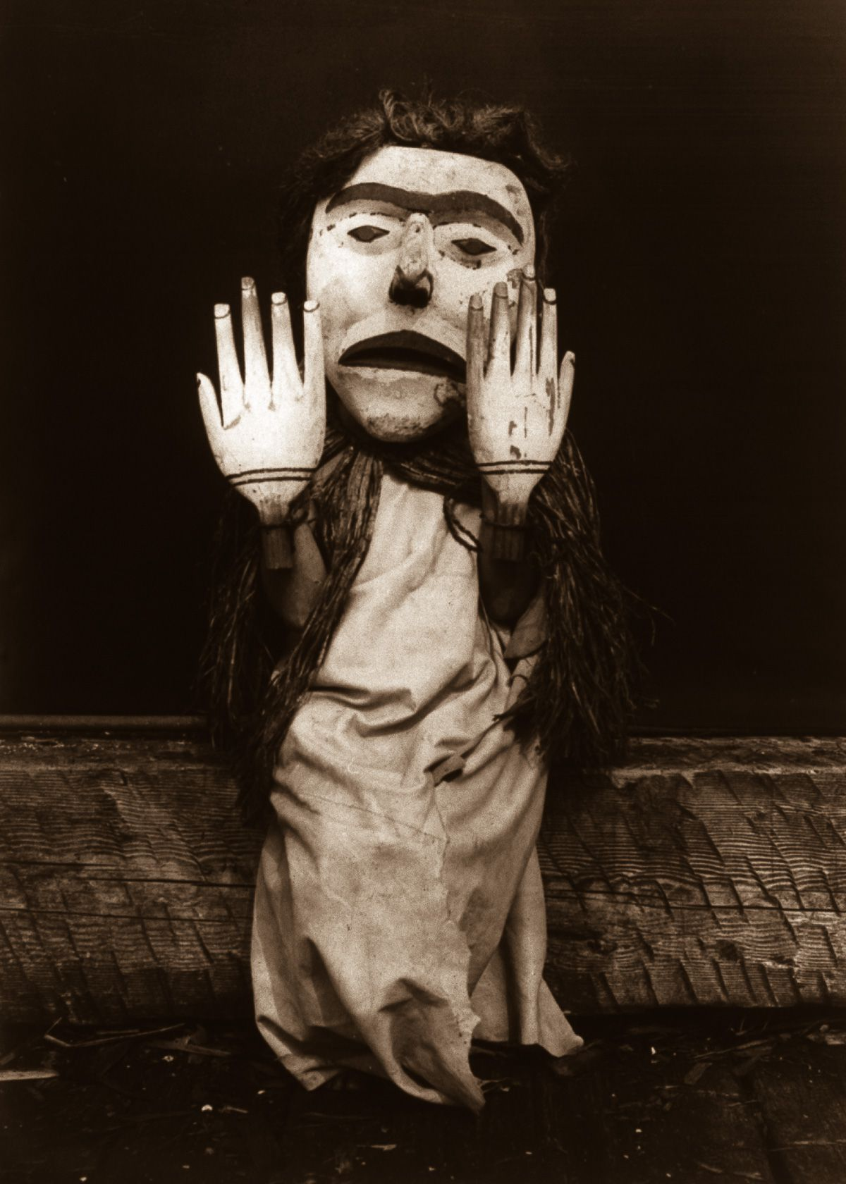 """A Kwakiutl person dressed as a forest spirit, Nuhlimkilaka, (""""bringer of confusion""""),  1914.  ©EDWARD S. CURTIS/LIBRARY OF CONGRESS"""