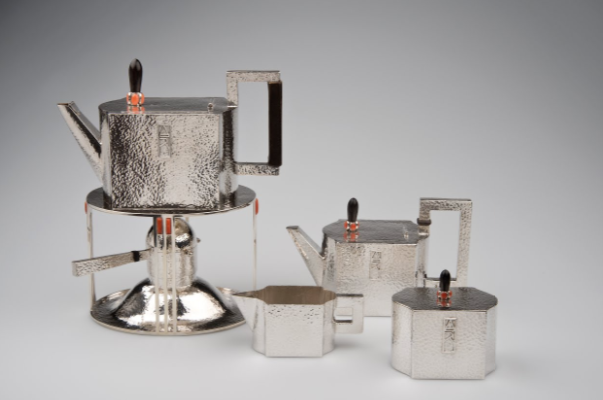 "Tea Service, by designer Josef Hoffmann1903    Photo: © MAK/Katrin Wisskirchen   From the collection of MAK – Austrian Museum of Applied Arts / Contemporary Art   ""The tea service which consists of a samovar, a teapot, a cream jug, and a sugar bowl belongs to the earliest objects made in the Wiener Werkstätte. These pieces of work are characterised by the geometrical contours of the objects. Cubes and squares are essential artistic elements which are a feature of Hoffmann's style in the early beginnings"" via Google Arts & Culture"