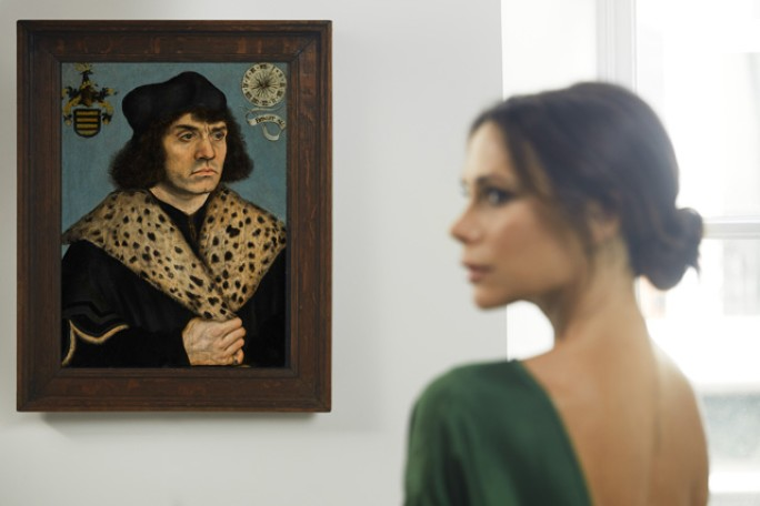 VICTORIA BECKHAM WITH   LUCAS CRANACH THE ELDER'S PORTRAIT OF A MAN WITH A SPOTTED FUR COLLAR. ESTIMATE £1,500,000—2,000,000  . PHOTOGRAPHED BY CHRIS FLOYD.