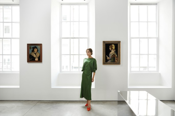 VICTORIA BECKHAM IN HER DOVER STREET STORE, 20 JUNE, 2018. PHOTOGRAPHED BY CHRIS FLOYD. L-R:  LUCAS CRANACH THE ELDER, PORTRAIT OF A MAN WITH A SPOTTED FUR COLLAR. ESTIMATE £1,500,000—2,000,000 ;  CIRCLE OF LEONARDO DA VINCI, PORTRAIT OF A LADY IN PROFILE. ESTIMATE £200,000—300,000 . FROM SOTHEBY'S OLD MASTERS EVENING SALE .