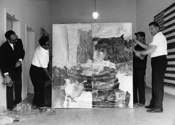 Installation of Rauschenberg's  Studio Painting  (1960–61),  XXXII Esposizione Biennale Internazionale d'Arte , Venice, 1964. Work in background is Jasper Johns's  Double Flag  (1962)  Photo: Ugo Mulas © Ugo Mulas Heirs.