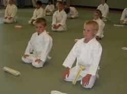Kneeling kids with new belt