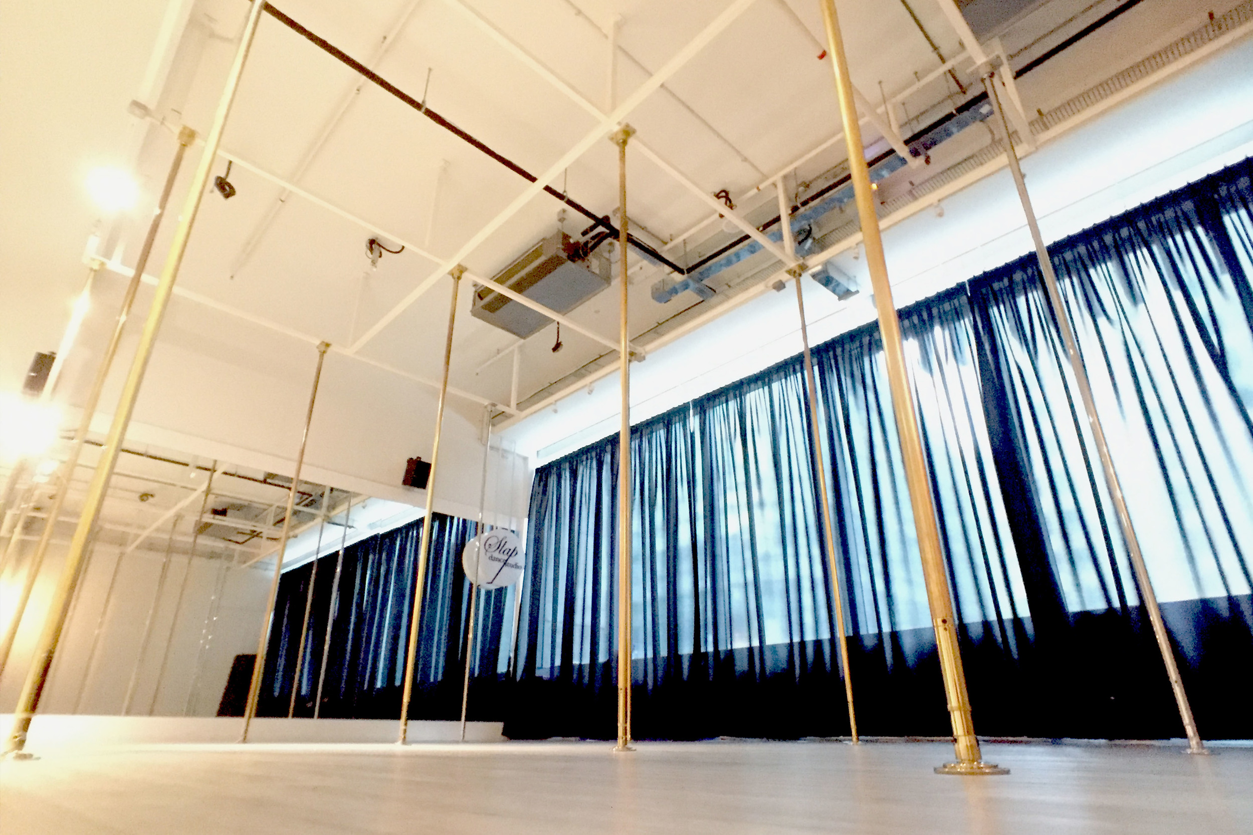 SLAP runs 3 dance studios at Robinson Square. We bring pole aficionado the highest poles in Singapore with a 4.6m ceiling height, comfortable distance between poles in a spacious 1200 square feet dance floor.