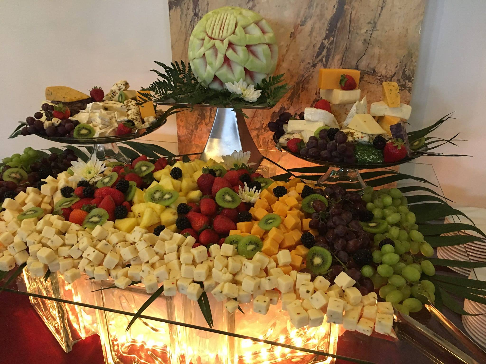 Carved Fruit and Gourmet Cheese Display