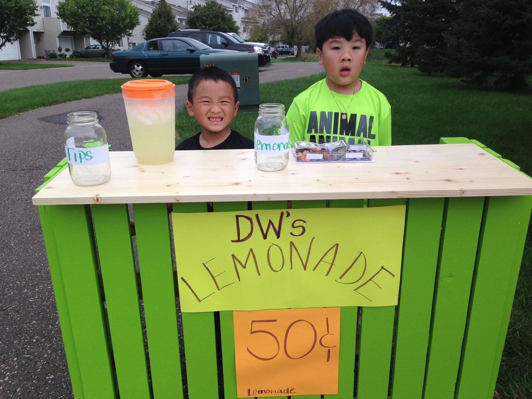 Zong's two business-minded sons celebrating the final days of summer with a lemonade stand.