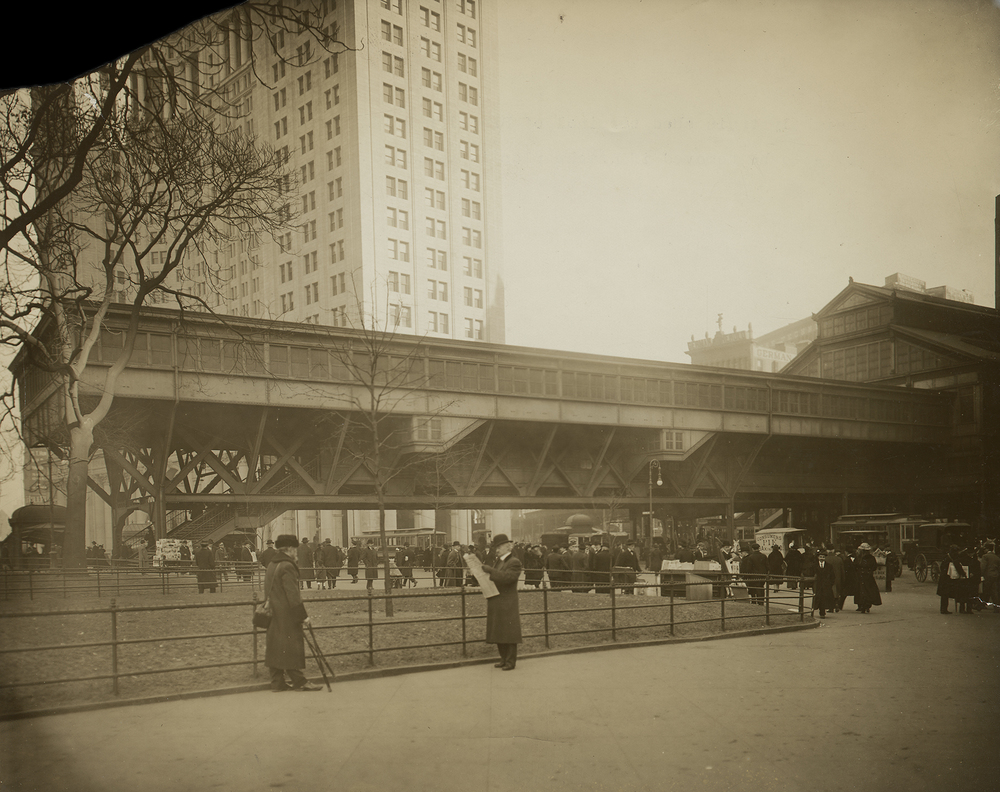"""Unsightly train shed terminal of Brooklyn Bridge extending across Park Row - to be removed if Kracke plan is approved,"" ca. 1920"