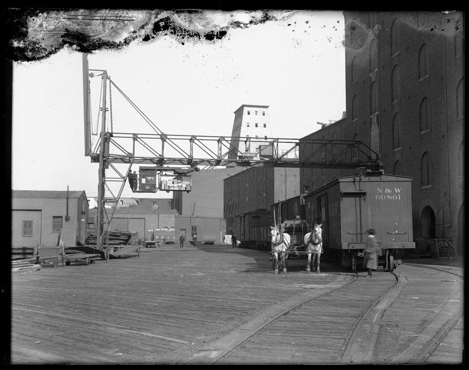 "Bush Terminal Transfer, Hoisting Crane - N.S. & W. Railroad Car, horse team (""Cotton Rags"" on wagon),1912.  NYC Municipal Archives."