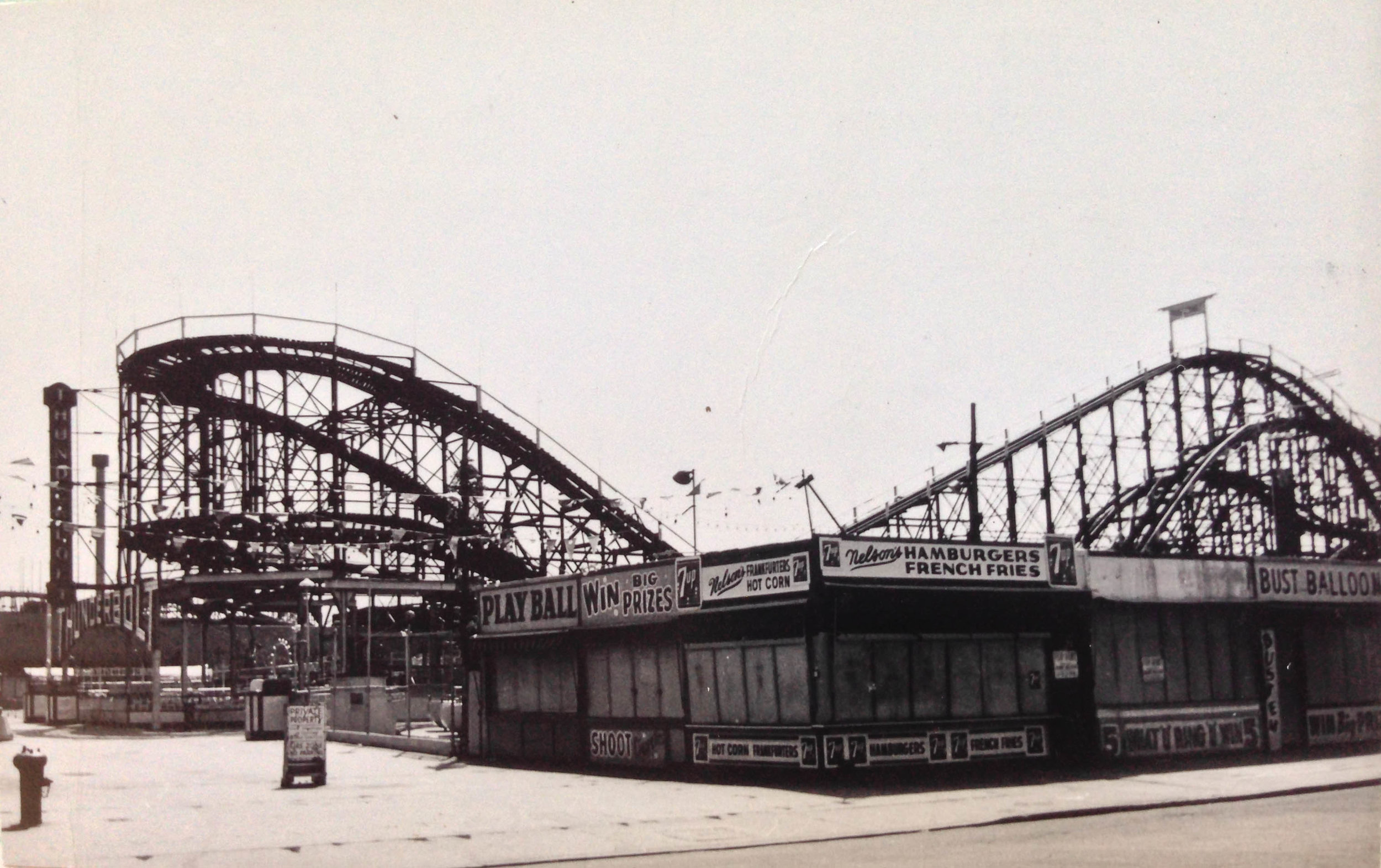 """Bowery between West 15th and 16th Streets, Brooklyn, 1964. The Thunderbolt roller coaster in Coney Island was built in 1925, two years earlier than the famous Cyclone. It made a cameo in Woody Allen's """"Annie Hall.""""Department of Finance Collection, NYC Municipal Archives."""