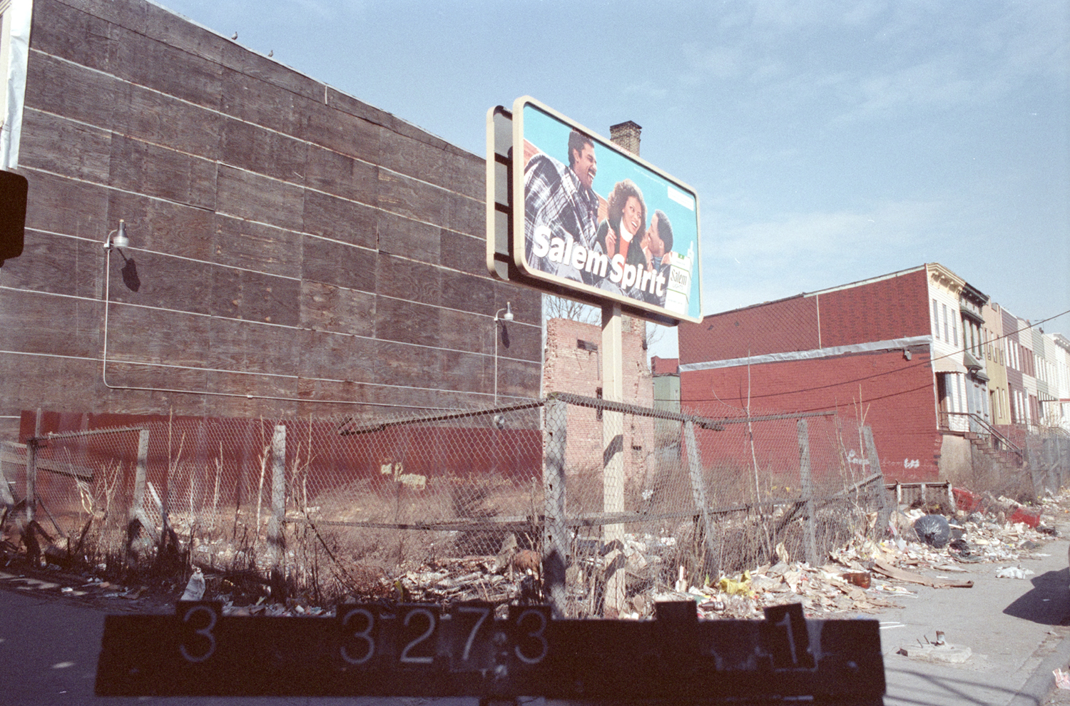 An empty lot shown here in the 1980s located at 1213 Broadway next door to what once was a furniture store. Department of Finance Collection, NYC Municipal Archives.