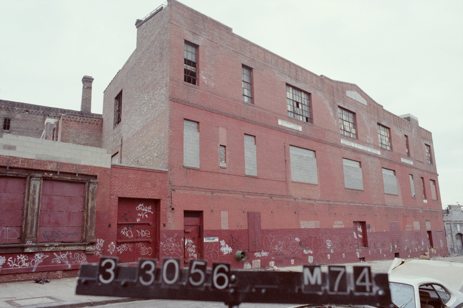 1 Bushwick Place in the 1980s, seen here in unkempt fashion. This former brewery would go on to become different music venues, including the Wick, and practice spaces. Department of Finance Collection, NYC Municipal Archives.