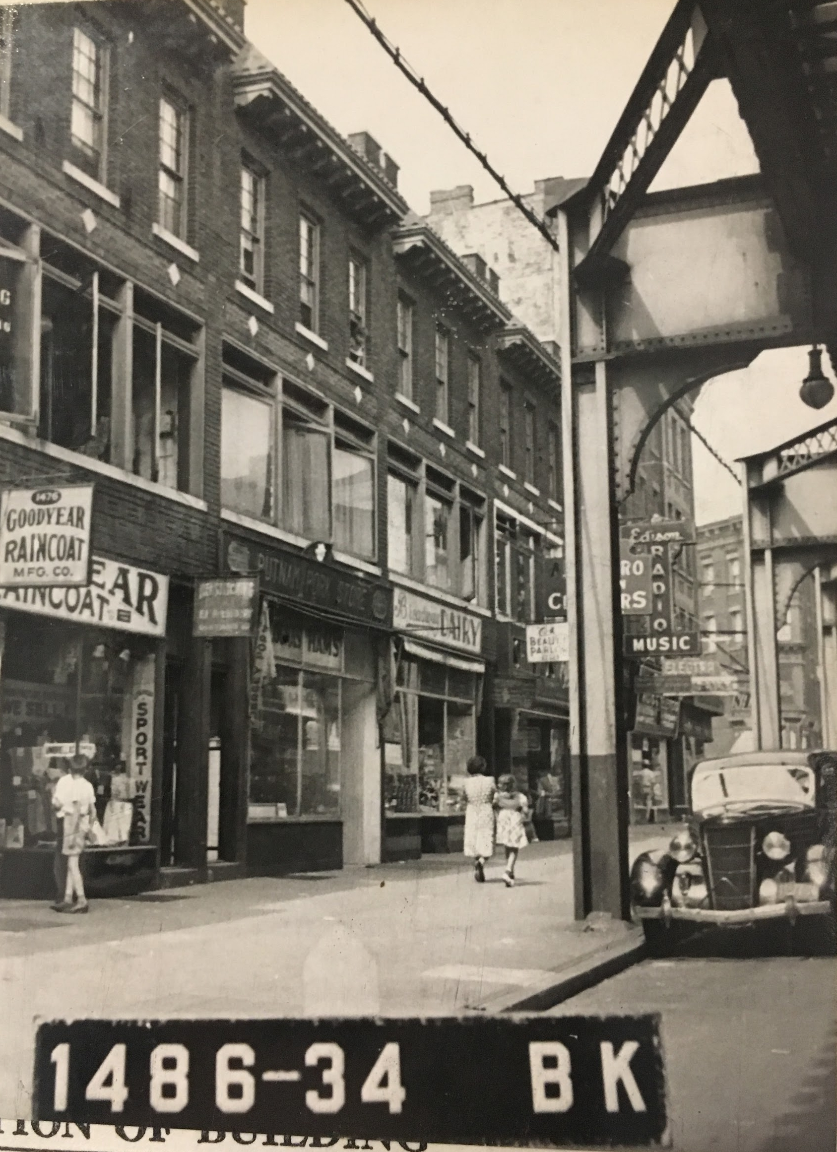 1474 Broadway shown here in the 1940s as a Pork Store, neighboring thriving businesses. Department of Finance Collection, NYC Municipal Archives.