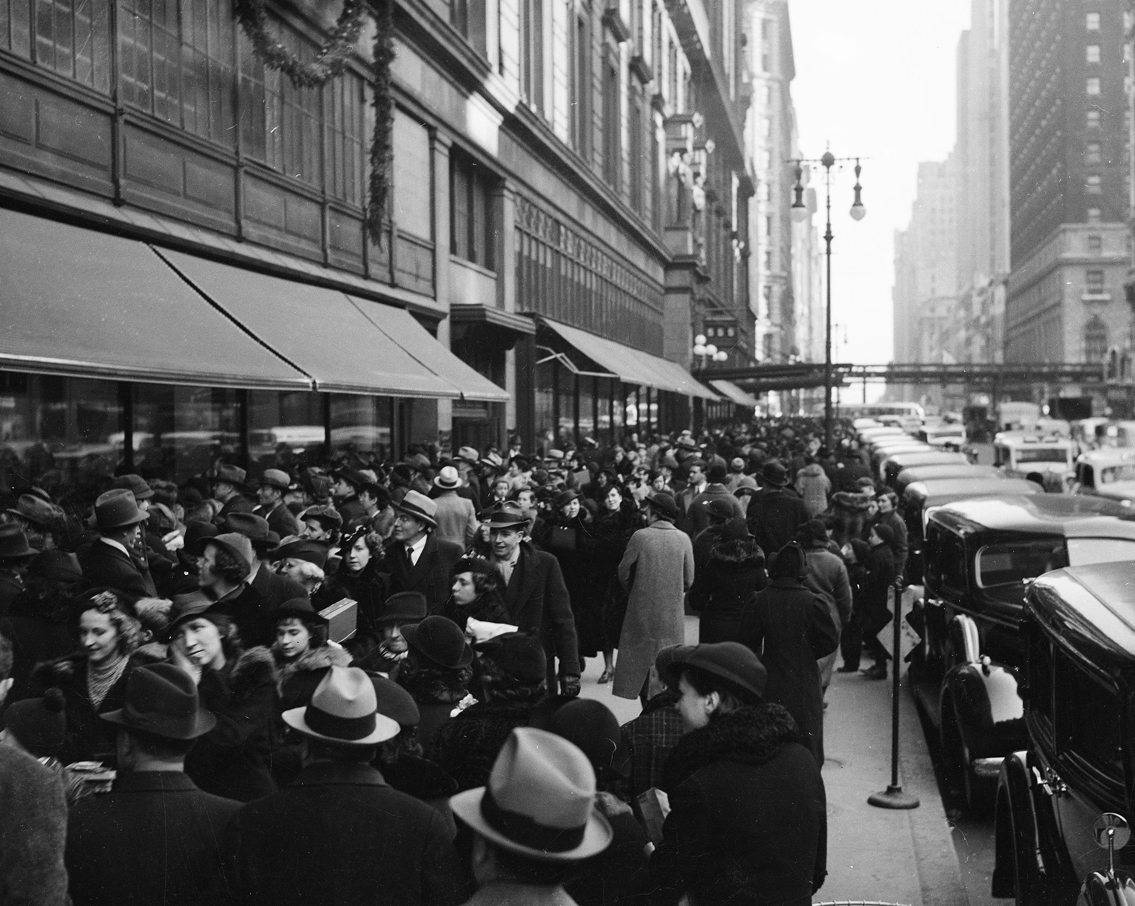 Christmas shoppers on West 34th Street,in front of Macy's, ca. 1937. WPA Federal Writers' Project Collection, NYC Municipal Archives.