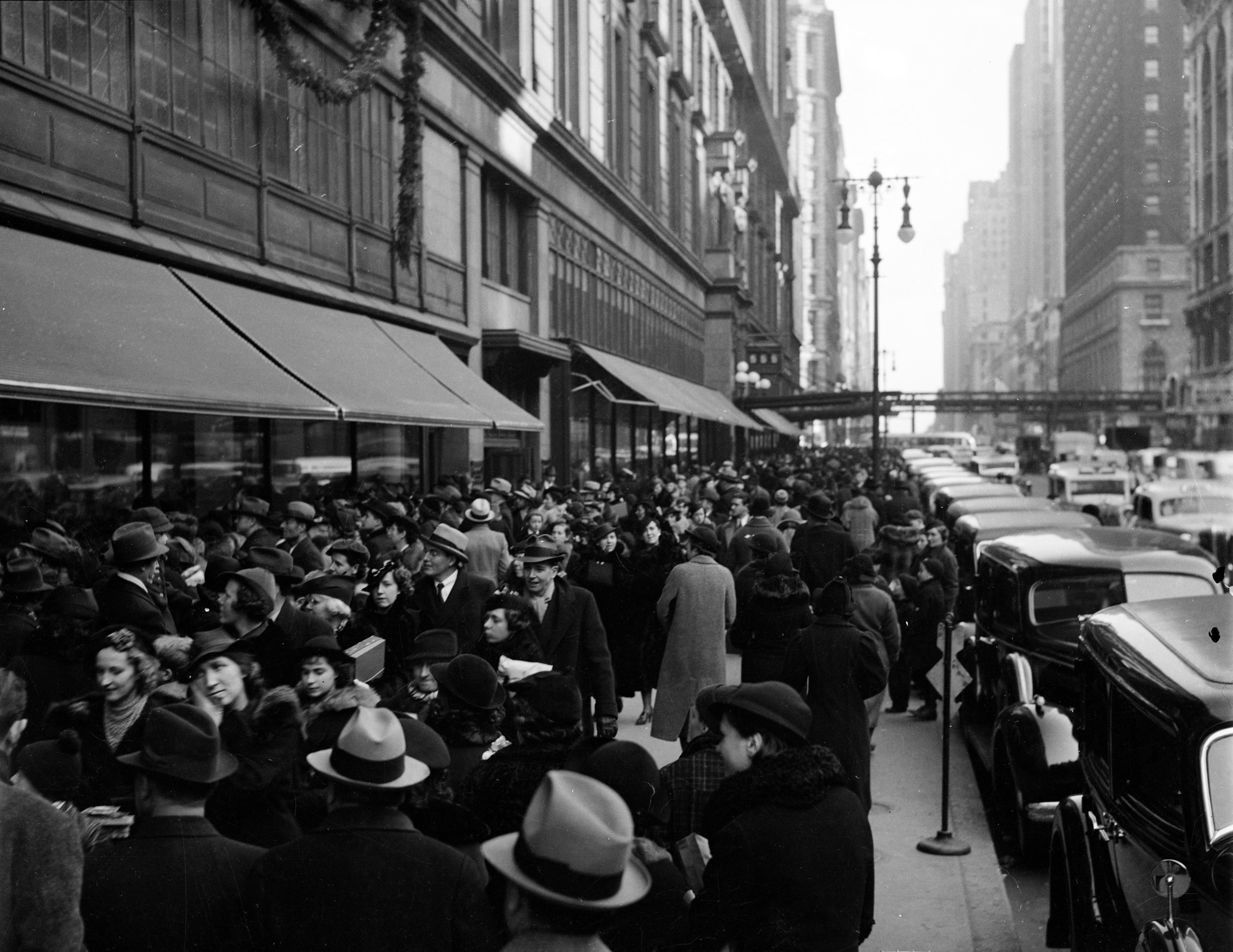 Christmas shoppers on West 34th Street outside of Macy's, ca. 1937. WPA Federal Writers' Project Collection, NYC Municipal Archives.