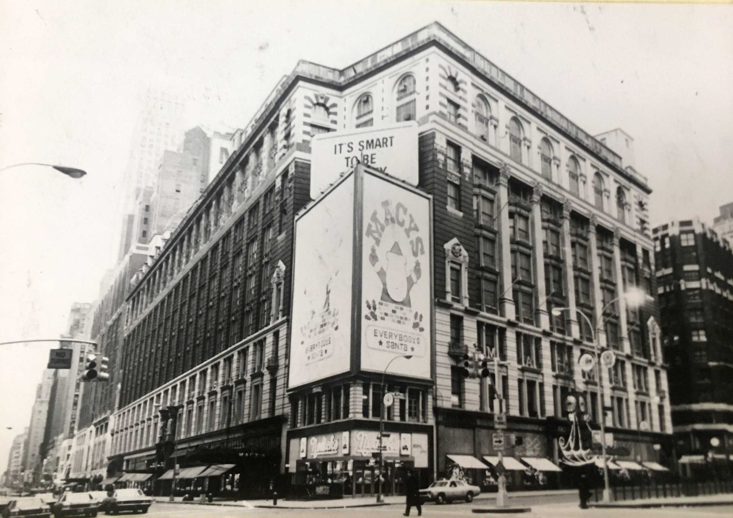 """1317-1329 Broadway, Macy's flagship building with ad saying """"Macy's-Everybody's Santa,"""" 1972. Department of Finance Collection, NYC Municipal Archives."""