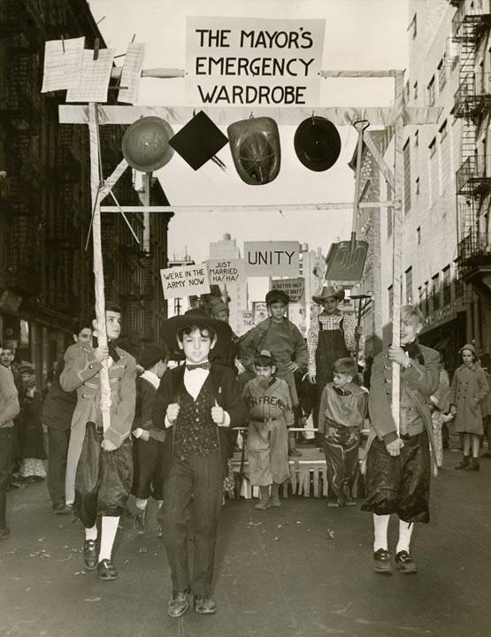"Madison Square Boys' Club Thanksgiving Day Parade. ""The Mayor's Emergency Wardrobe Hanging fireman's helmet, mortarboard, shovel, music."" November 1940, Mayor Fiorello H. LaGuardia, NYC Municipal Archives."