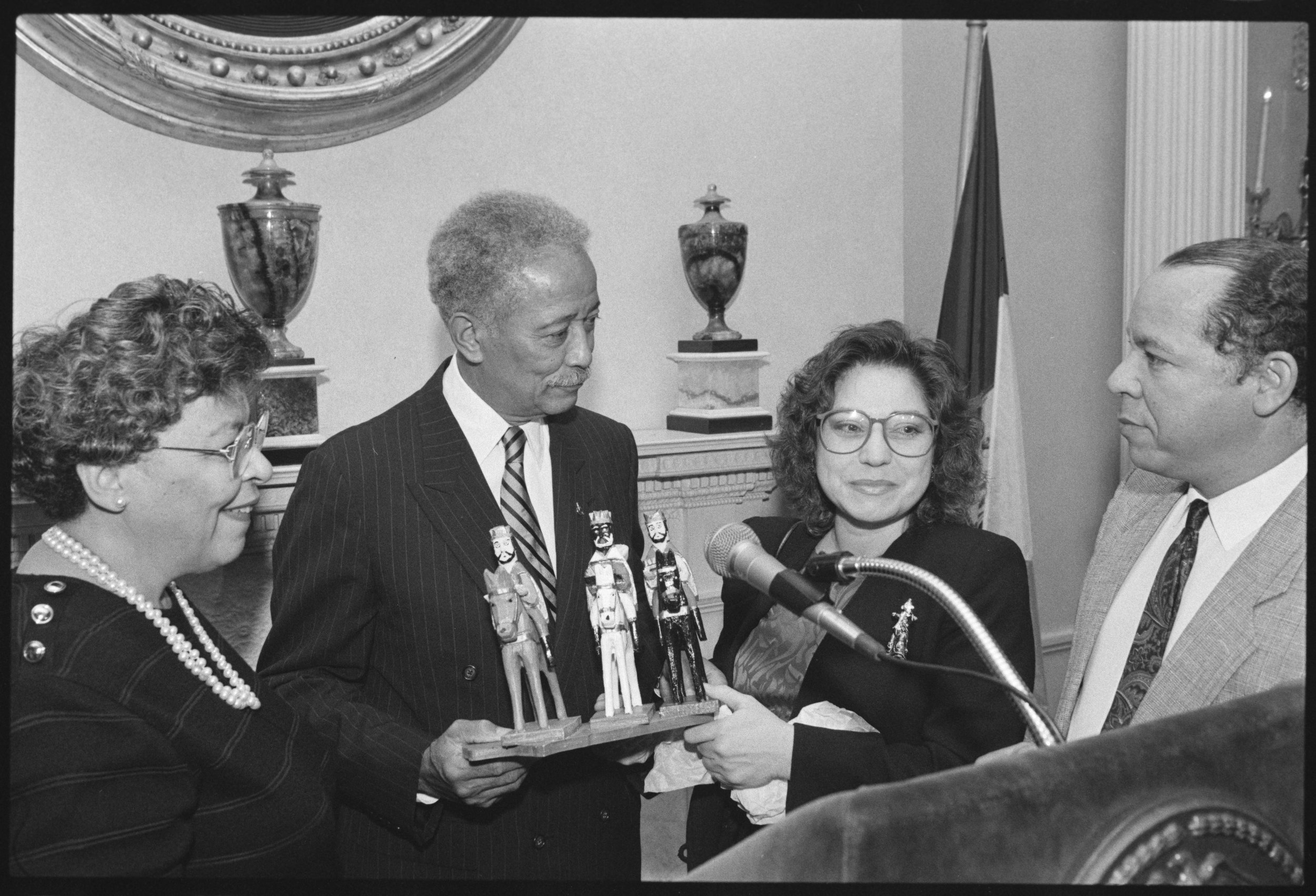 Mayor and Mrs. Dinkins were presented with a wood carving of the Three Kings during a Three Kings Day Feast in 1993. Mayor Dinkins Collection, NYC Municipal Archives.