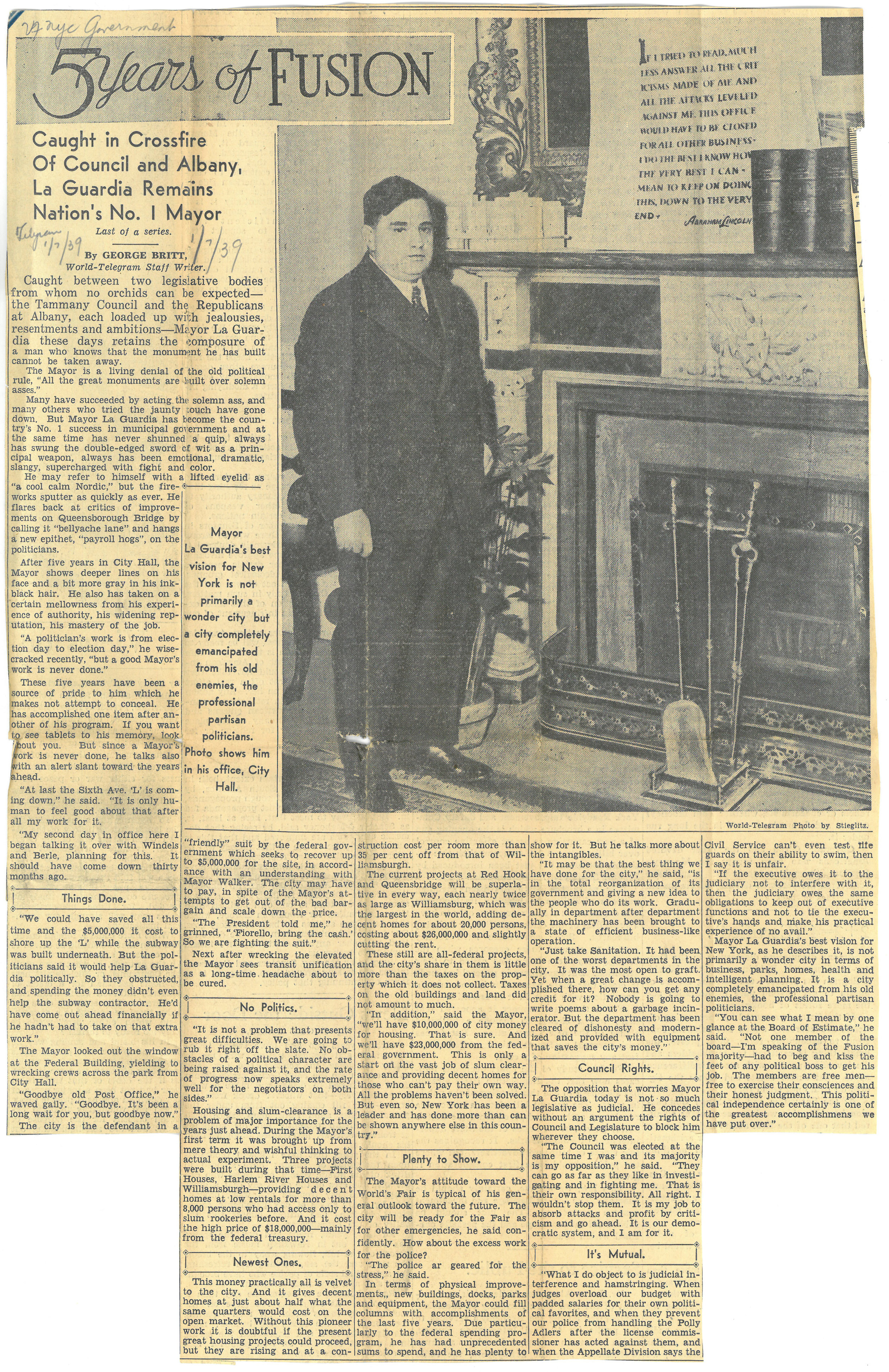 A remarkably youthful-appearing Mayor Fiorello LaGuardia stands before a fireplace in City Hall shortly after his inauguration for a second (of three) terms as Mayor (photograph courtesy of the  World Telegram ). NYC Municipal Library.